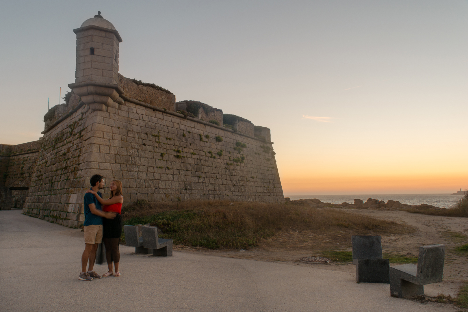 Couple and the Sunset over the Beach Fort in Porto Portugal